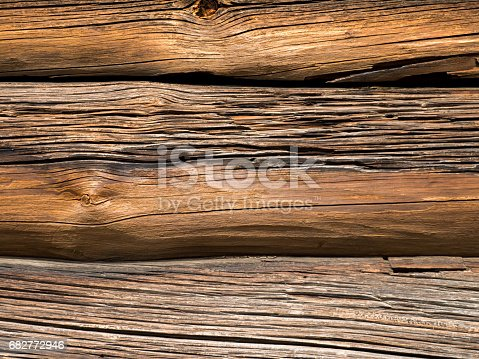 istock Dark wooden weathered logs cabin wall background 682772946