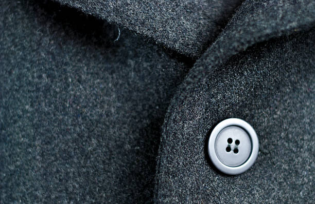 Dark wool coat with one black button stock photo