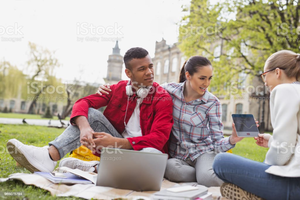 Dark-haired girl showing some photo to her friend royalty-free stock photo