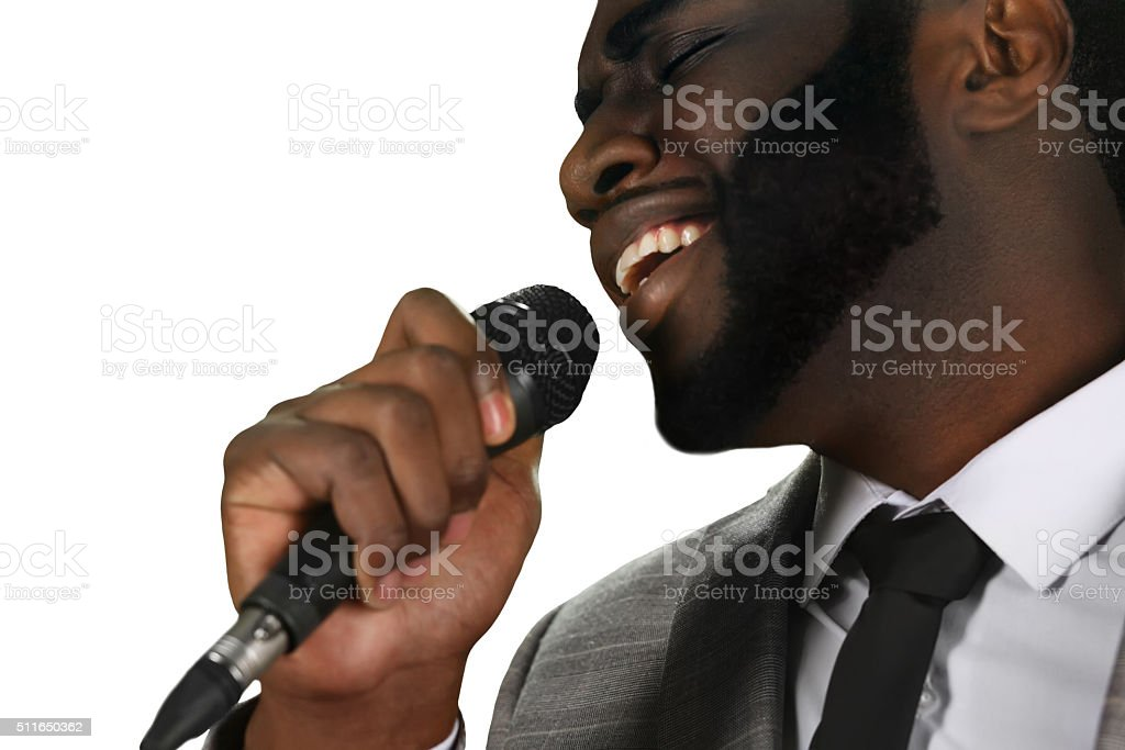 Darkskinned singer perfrorming. stock photo