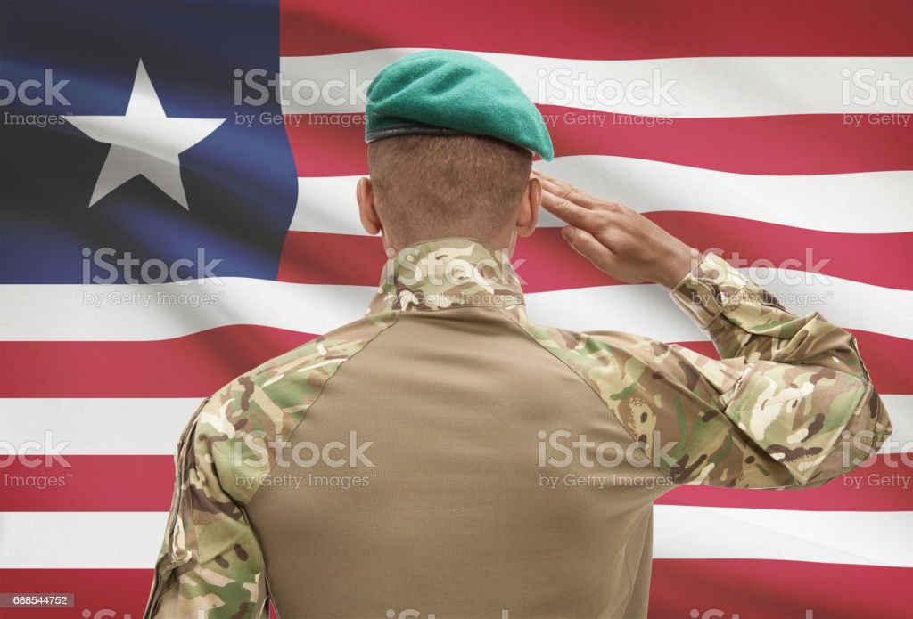 Darkskinned Soldier With Flag On Background Liberia Stock