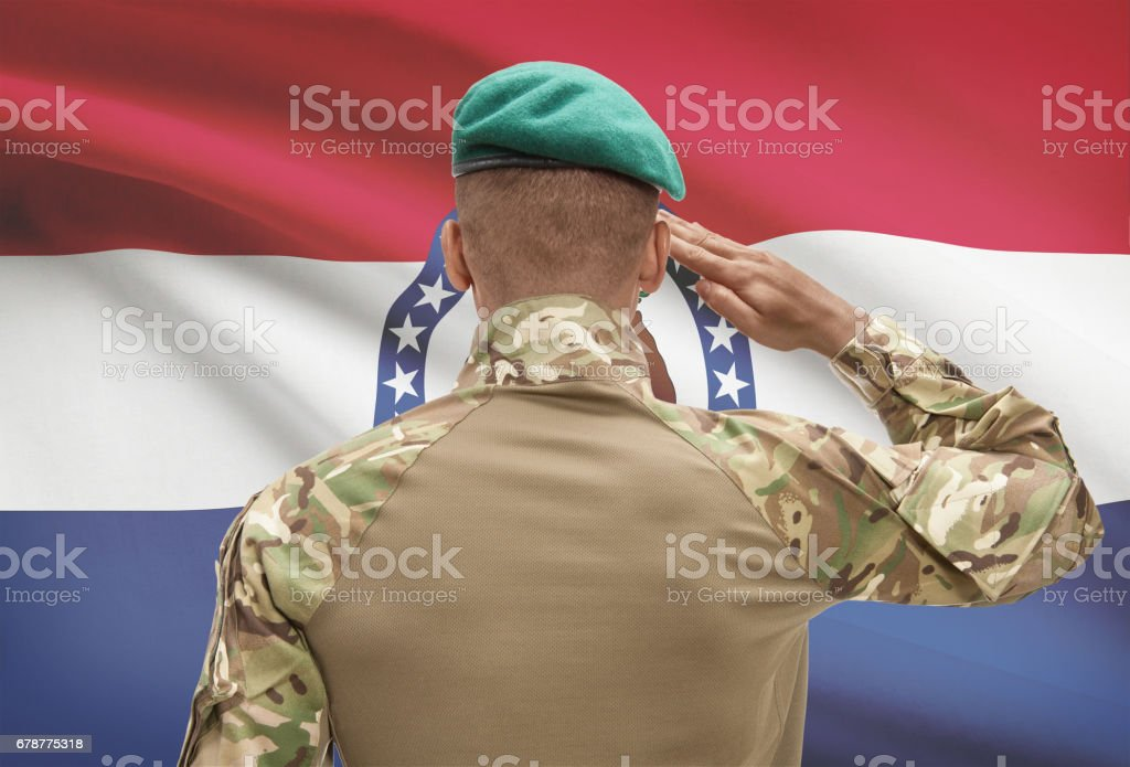 Dark-skinned soldier with US state flag on background - Missouri royalty-free stock photo