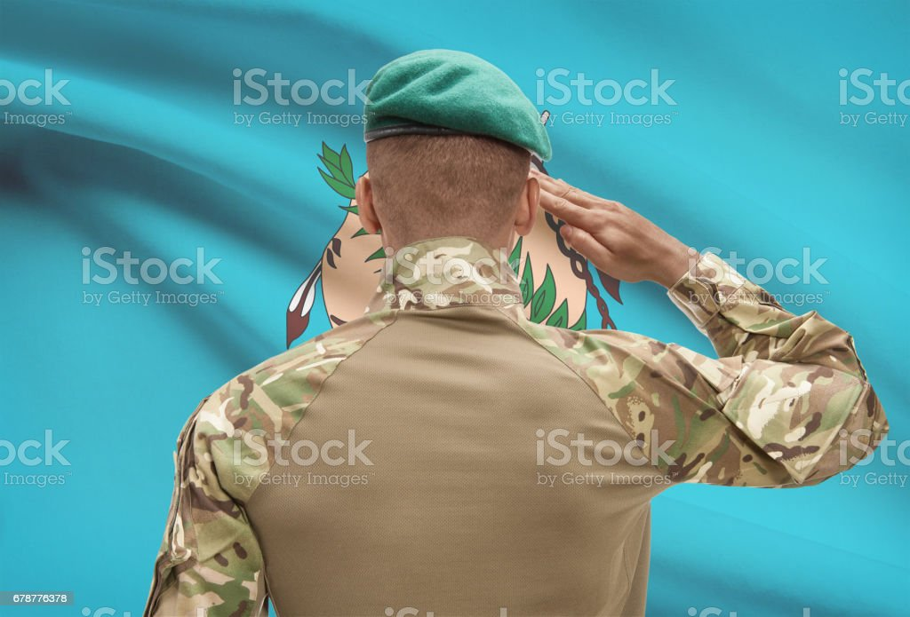 Dark-skinned soldier with US state flag on background - Oklahoma royalty-free stock photo