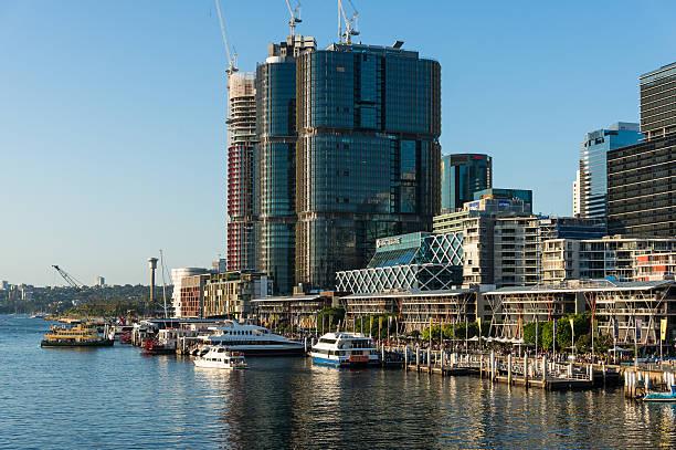 darling harbour promenade with views of barangaroo buildings - barangaroo stock photos and pictures