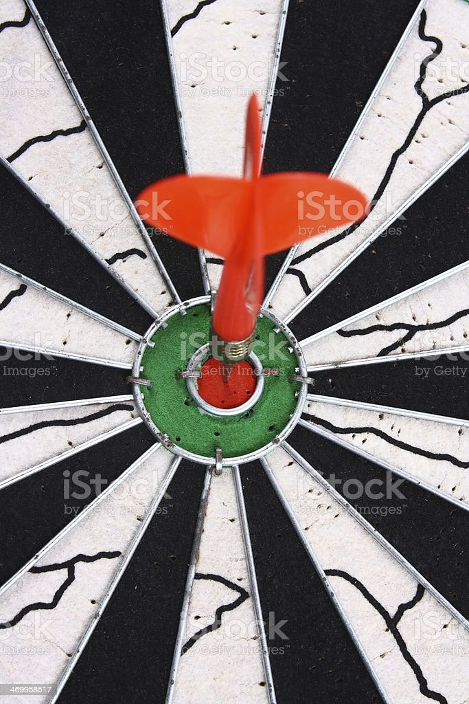 Dart and dartboard royalty-free stock photo