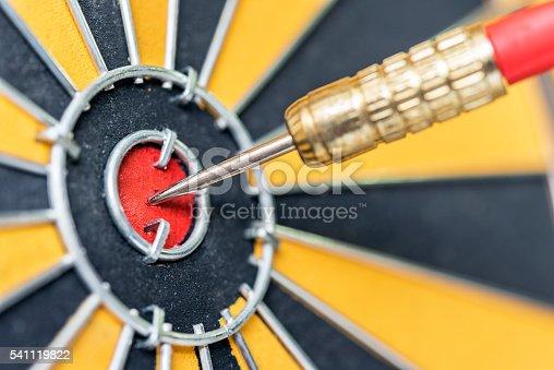 886643538 istock photo dart arrow hitting in target bullseye of dartboard 541119822