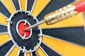 istock dart arrow hitting in target bullseye of dartboard 541119822