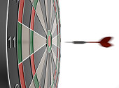 istock Dart arrow hitting in the target center of dartboard 587802194