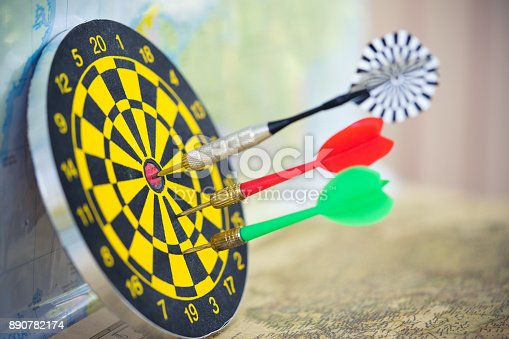 istock Dart arrow hitting in the target center of dartboard with modern city and sunset background. Target business, achieve and victory concept. 890782174