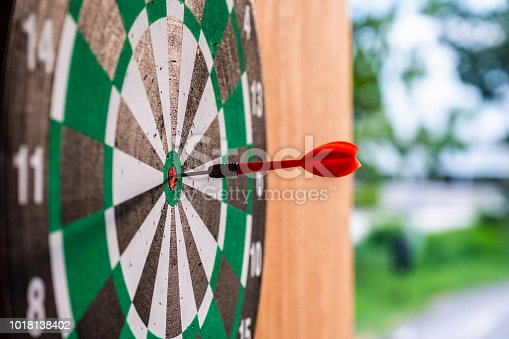886643538 istock photo Dart arrow in bullseye target on dartboard 1018138402