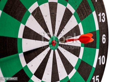 886643538 istock photo Dart arrow in bullseye target on dartboard 1018138422