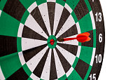 istock Dart arrow in bullseye target on dartboard 1018138422