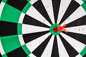 istock Dart arrow in bullseye target on dartboard 1021031320