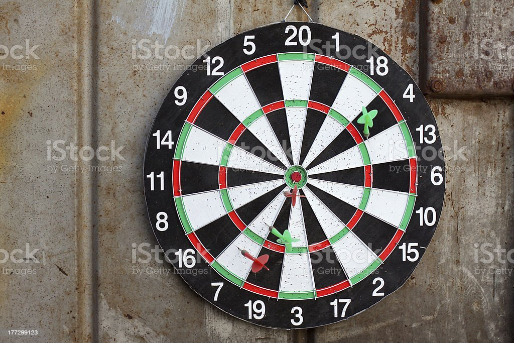Dart board on grunge metal background royalty-free stock photo
