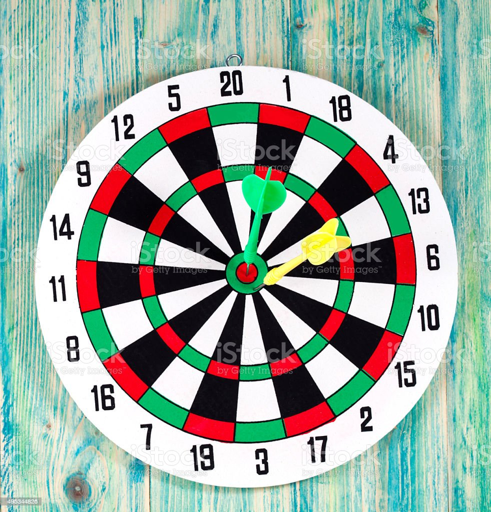 dart board with darts on background stock photo