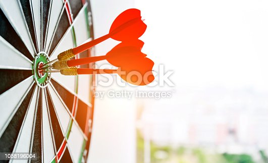 469652019 istock photo Dart board with three darts outdoors 1058196004
