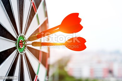 istock Dart board with three darts outdoors 1058196006
