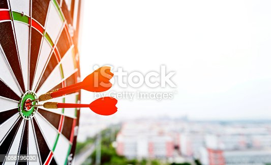 istock Dart board with three darts outdoors 1058196030