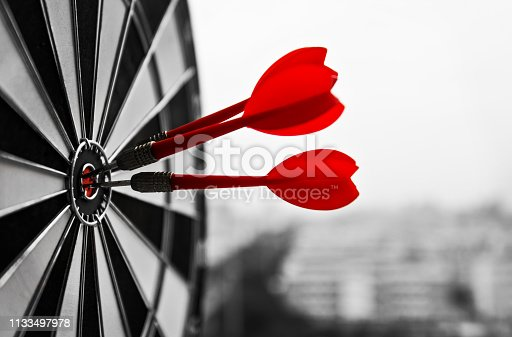Dart board with three darts outdoors.