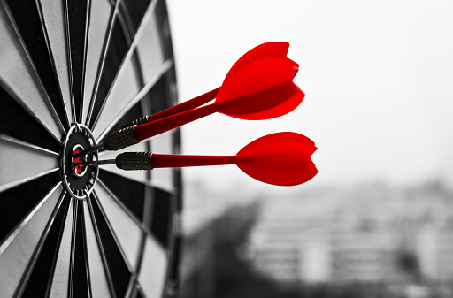 istock Dart board with three darts outdoors 1133497978