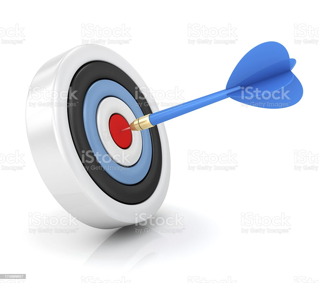 Dart hitting target stock photo