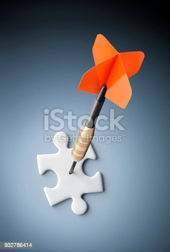 istock Dart in a puzzle piece 932786414