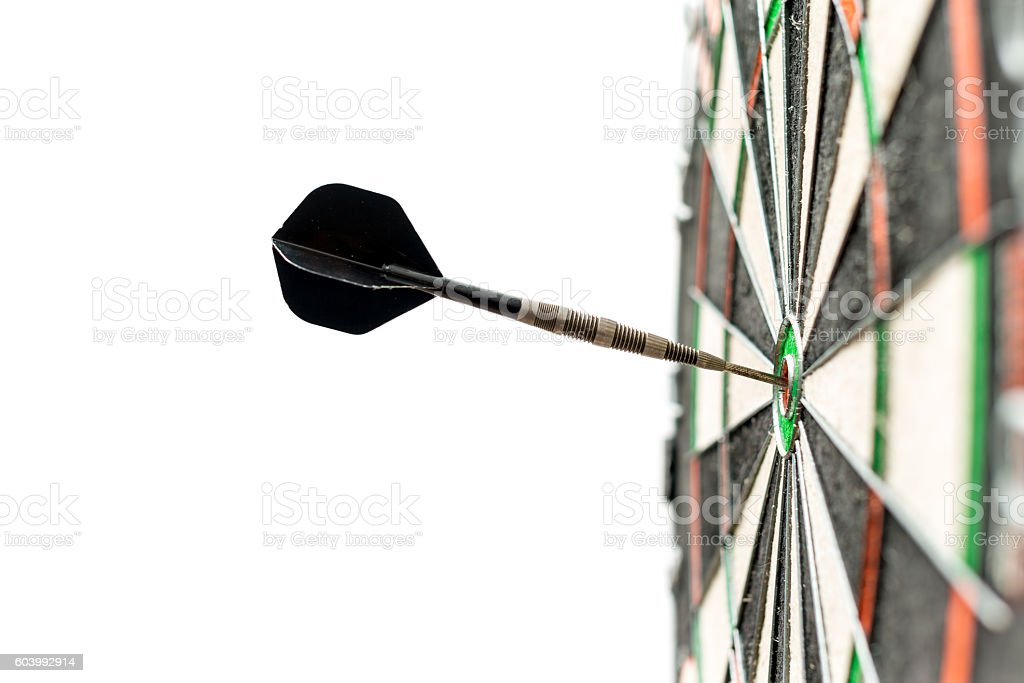 Dart in bulls-eye stock photo