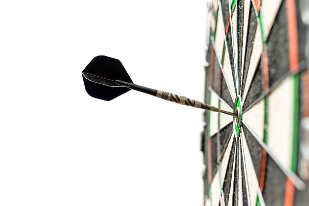 dart in bulls-eye - sports target stock photos and pictures