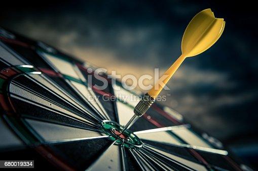 886643538 istock photo Dart in center of target 680019334