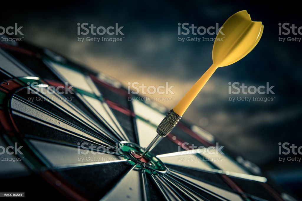 Dart in center of target stock photo