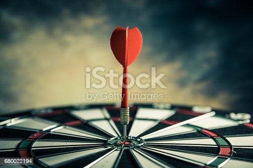 886643538istockphoto Dart in center of target 680022194