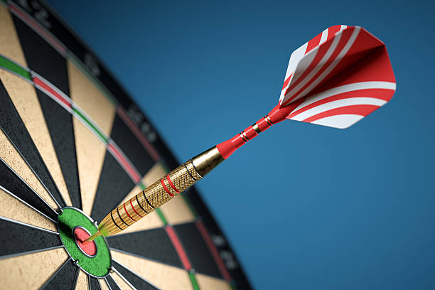 Dart in center of the target dartboard stock photo