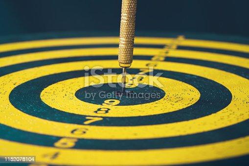 istock Dart in dartboard bullseye 1152078104