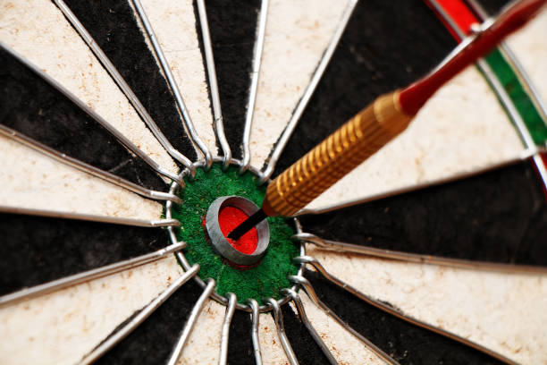 Dart in the center of the target! stock photo