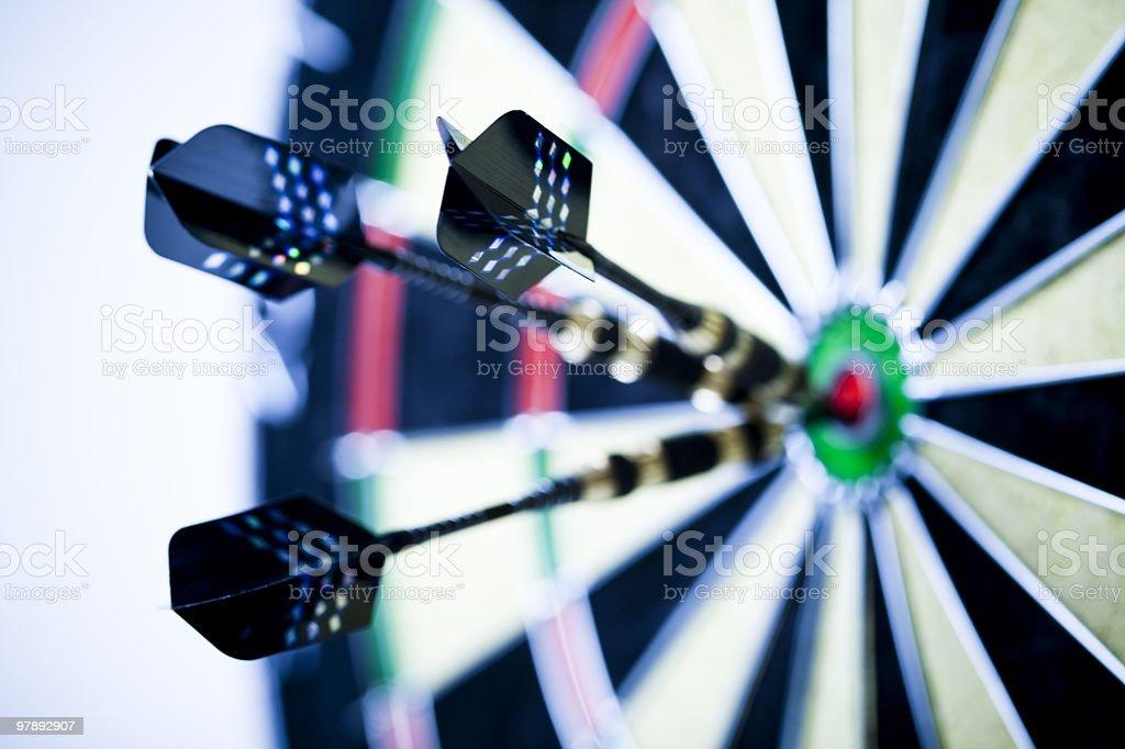 Dart on bulls eye target of dartboard royalty-free stock photo