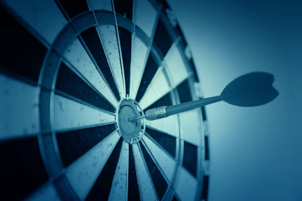 dart on target business leadership concept - sports target stock photos and pictures