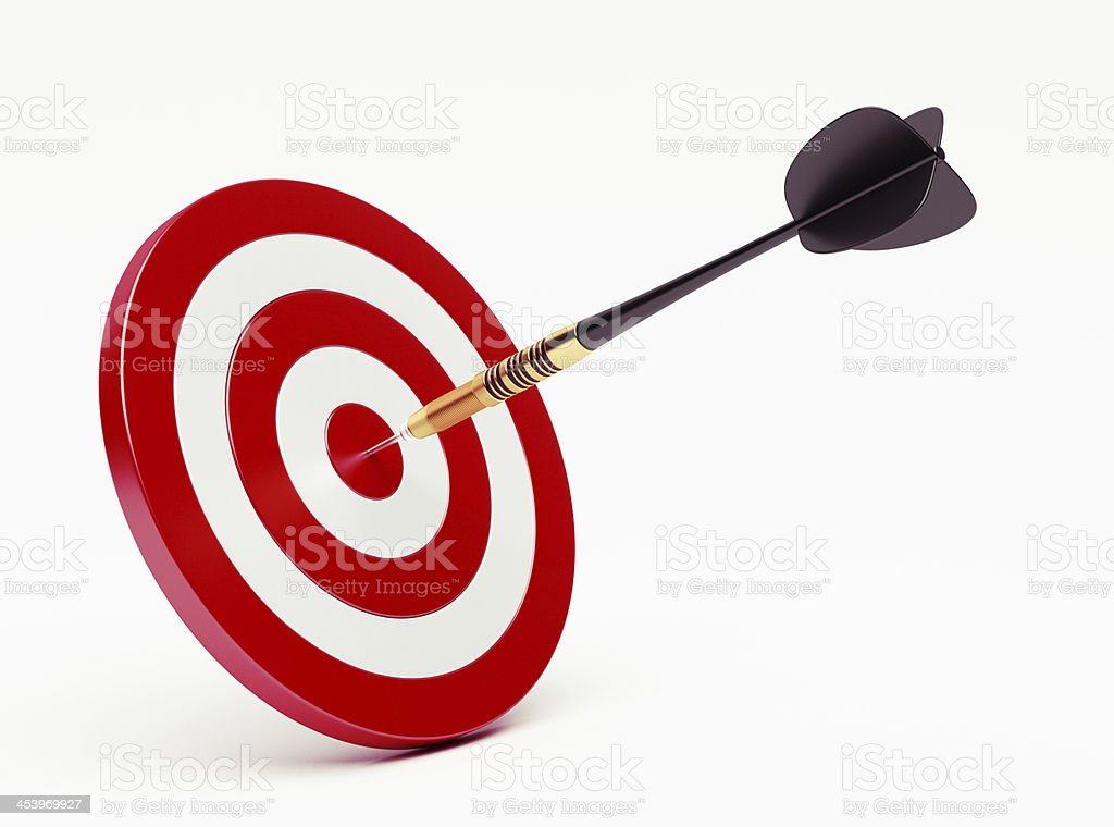 Dart striking the bullseye isolated on white background stock photo