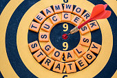 istock dart target on bullseye with success words 541124012