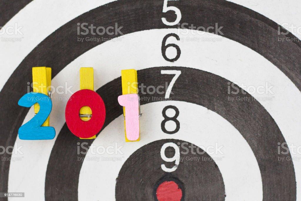 dart target  on wooden alphabet 2018 new year concept. stock photo
