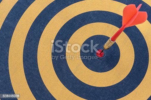 istock dart target with arrow on bullseye 528445028