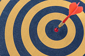 istock dart target with arrow on bullseye 528445028