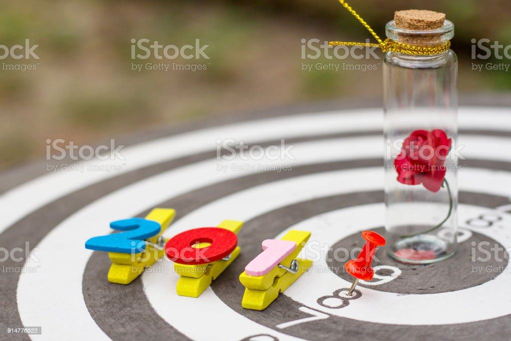 dart target with red pin on wooden alphabet 2018 new year concept. stock photo