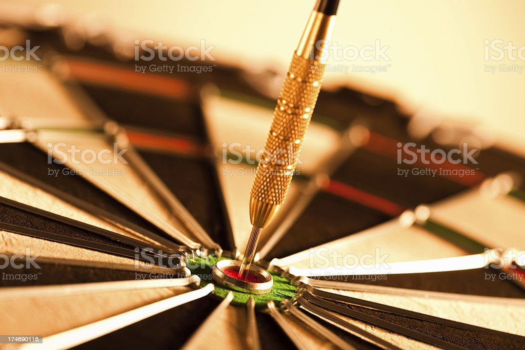 Dart targeted on the bulls eye royalty-free stock photo