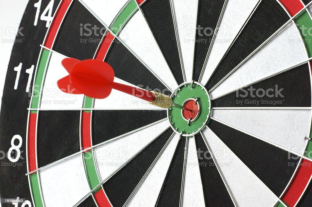 Close-up of a dart bull\'s eye on dartboard.