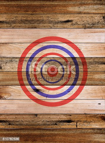 istock Dartboard target on old wooden wall 510782536
