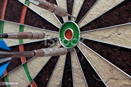 Classic dartboard with three darts