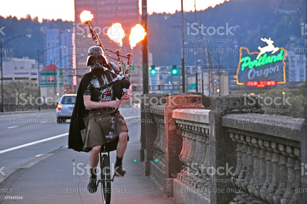 Darth Vader Riding a Unicycle Playing Flaming Bagpipes in Portland stock photo