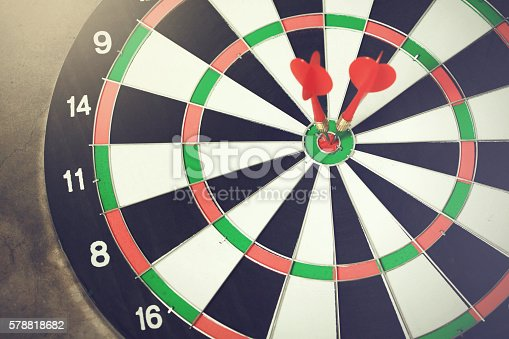 istock Darts accurately and perfectly hit the red spot on board 578818682