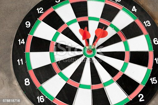 istock Darts accurately and perfectly hit the red spot on board 578818716