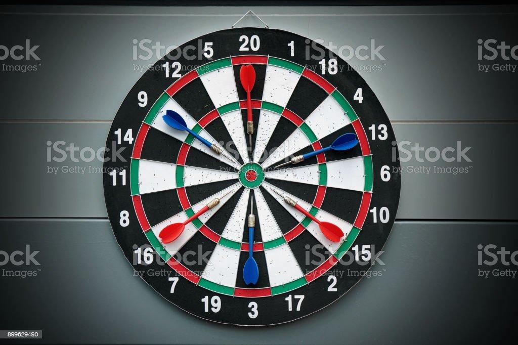 Darts and dartboard arrow game stock photo